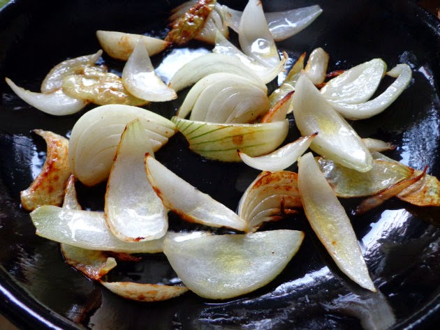 Add onion to another pan and saute
