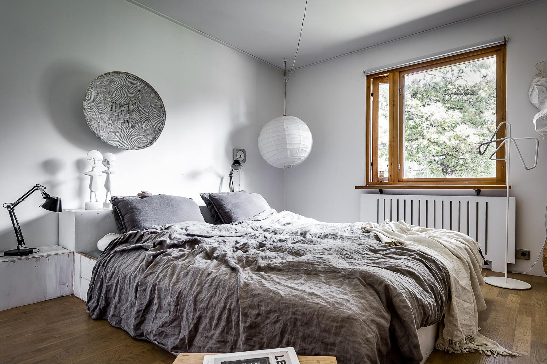 Scandinavian design villa with oriental and minimalist elements, bedroom  decor