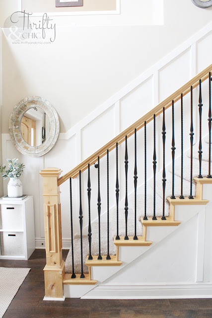 two story entry way with board and batten staircase and walls. Knotty alder and wrought iron banister.