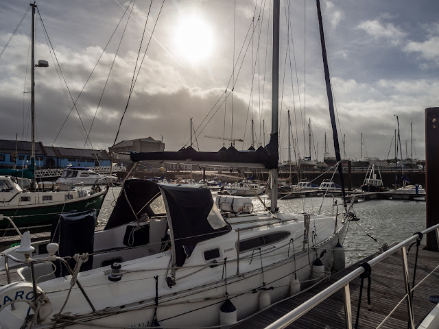 Photo of sun breaking through the clouds at Maryport Marina on Tuesday morning