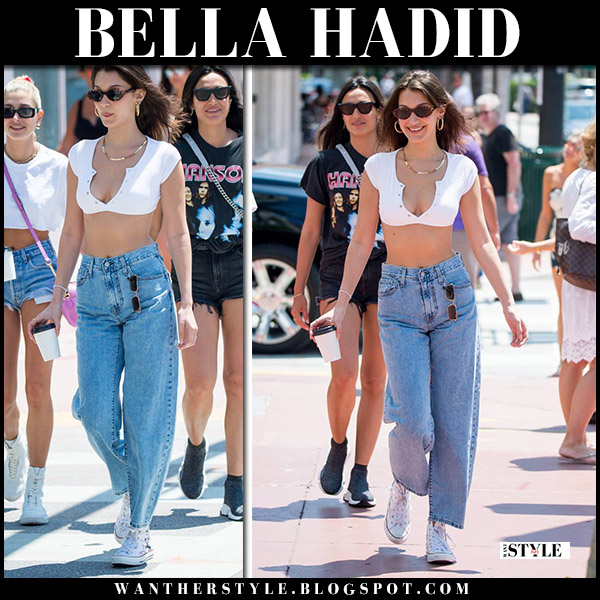 Bella Hadid in white crop top and baggy jeans levi's model street style april 29