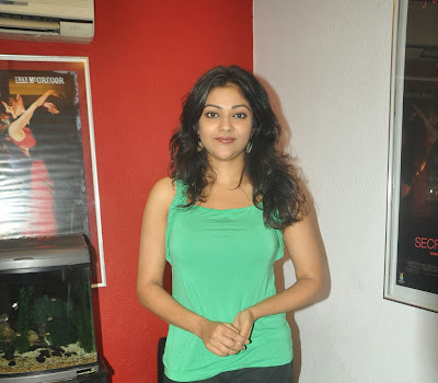 Abhirami photos in green sleeveless top