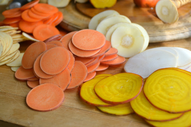 Root veggies sliced on a mandoline for homemade chips