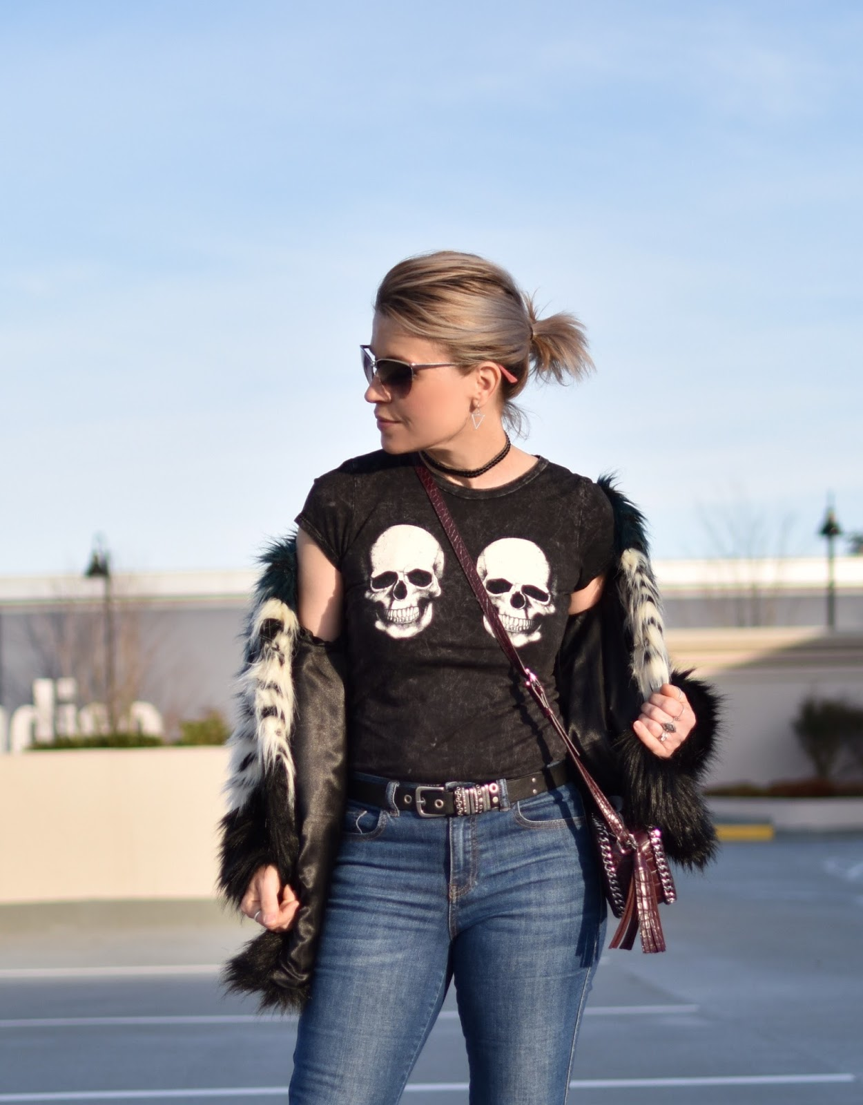 Monika Faulkner outfit inspiration - skull-motif tee, faux-fur jacket, sunglasses, cross-body bag