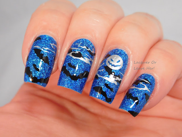 Winstonia Horror Night plate over Blue-Eyed Girl Lacquer Deep Blue Dream stamped with Messy Mansion polishes