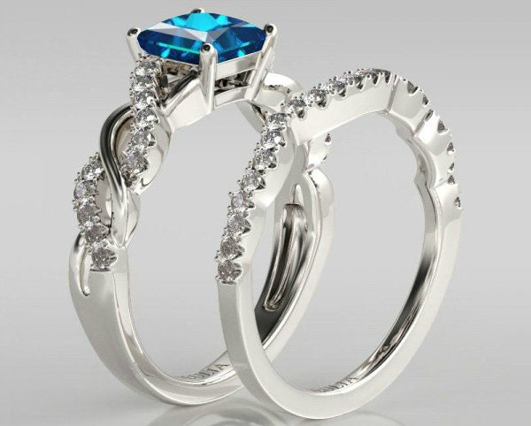 http://www.jeulia.com/black-friday-sales/twist-princess-cut-aquamarine-rhodium-plated-sterling-silver-bridal-set-wedding-ring.html