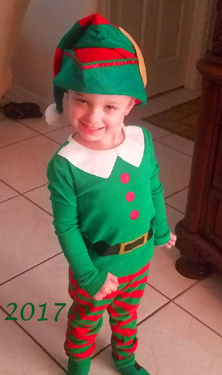 my grandson Antonio in an elf suit