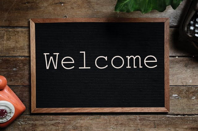 Welcome is written on black board