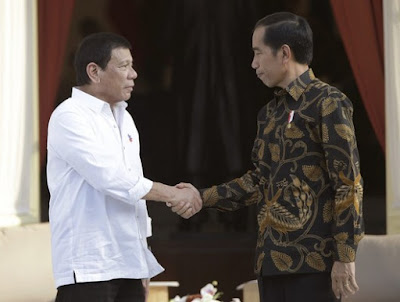 President Duterte, left, and President Widodo, right.