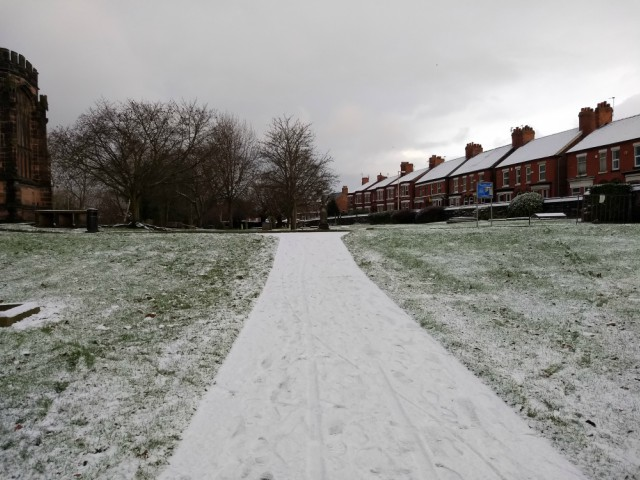 Snowy path through the churchyard