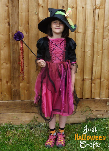 Child dressing up as a witch for Halloween