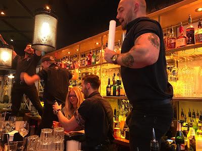 Bar staff at Be At One dancing on bar