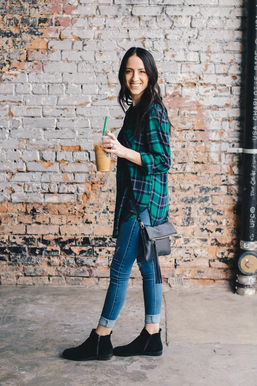 Casual weekend style in a plaid, flat suede booties and fringe cross body bag