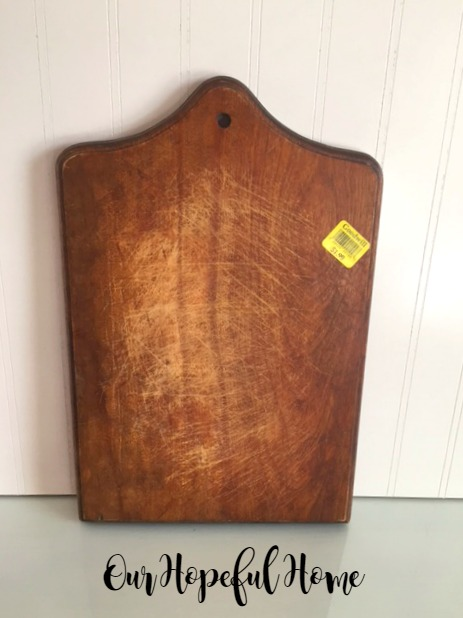thrift store wooden cutting board with scratches