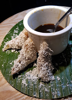 Some of the kueh-kueh (snacks) at the buffet. This coconut-covered kueh is eaten with gula melaka (coconut sugar syrup).