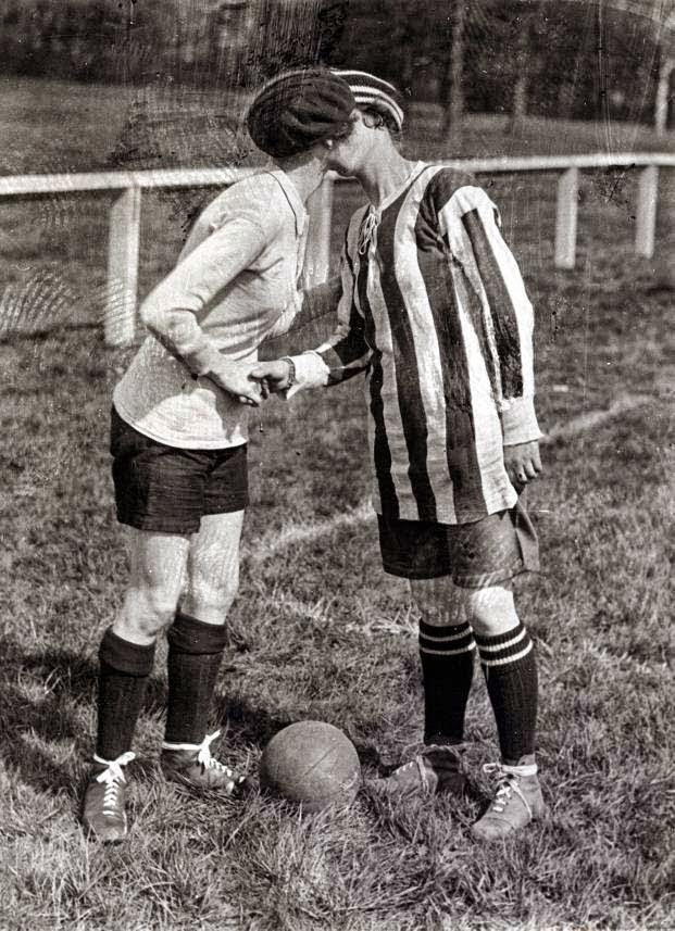 football soccer women kiss