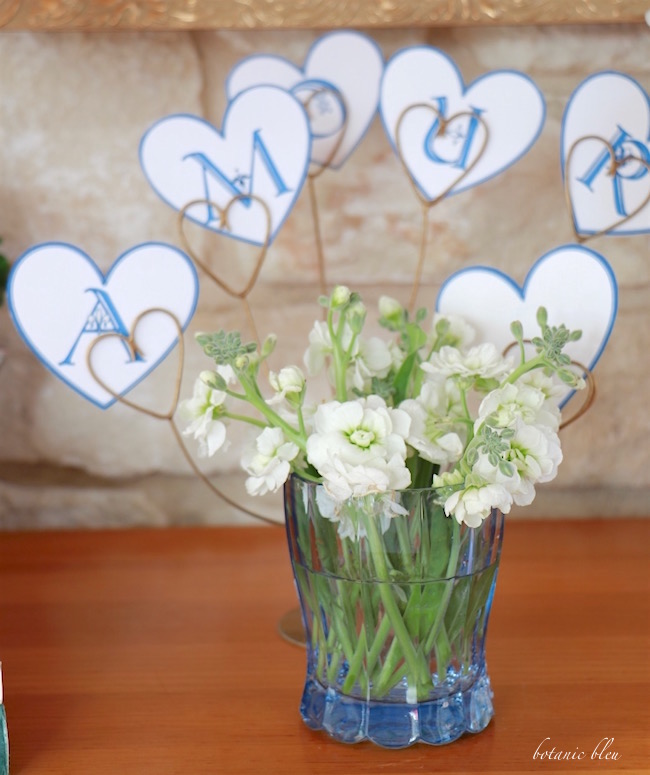 vintage-blue-glass-holds-stock-flowers