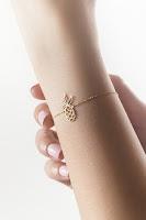 14k yellow gold pineapple bracelet with tiny white diamond