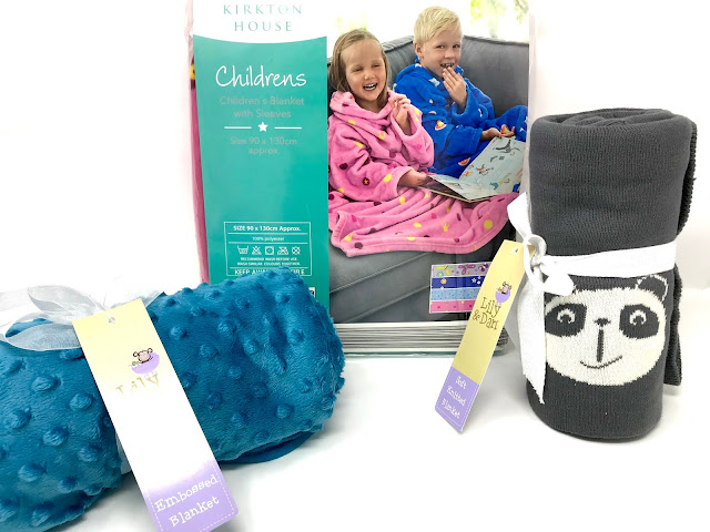 A binky fabric blue blanket, a grey tight knitted blanket and a pink children's blanket with arms