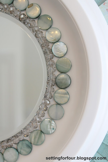 Beautiful Home Decor Idea! Learn how to make this gorgeous DIY Sunburst Mirror using a ceiling medallion and beads! Includes a step by step fun tutorial with full instructions and supply list. Perk up a wall in any room with this bead and paper craft idea. Customize it with other colors too!