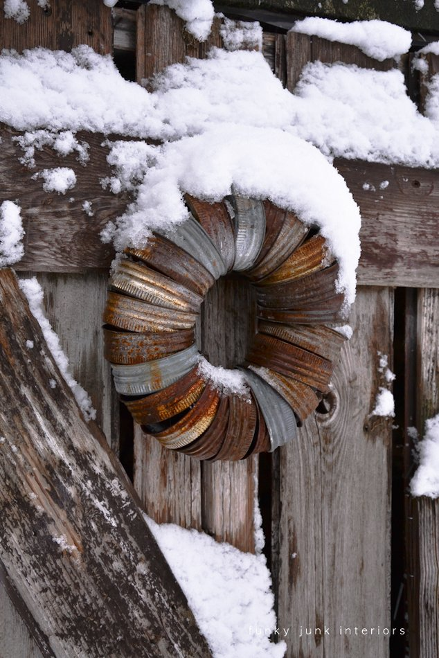 Rusty canning jar lid wreath on a snowy shed door via Funky Junk Interiors