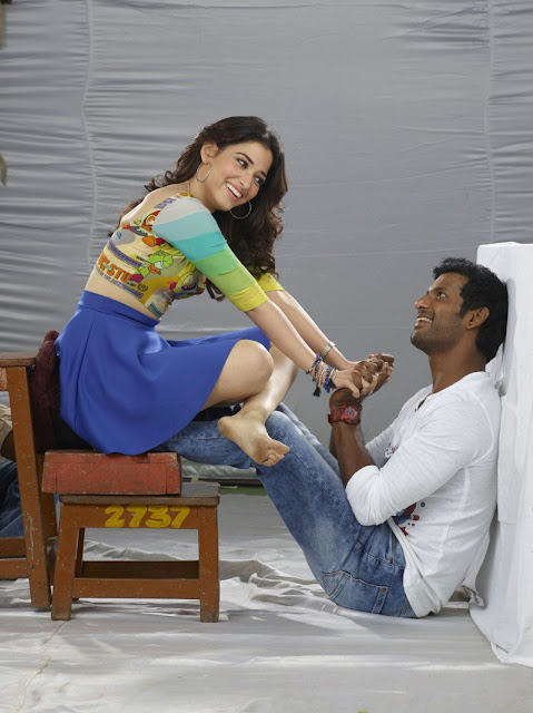 Tamanna in skirts in kaththi sandai movie
