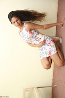 Nishi Ganda stunning cute in Flower Print short dress at Tick Tack Movie Press Meet March 2017 078.JPG