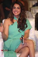 Actress Isha Koppikar Pos in Green Dress at Keshava Telugu Movie Audio Launch .COM 0037.jpg