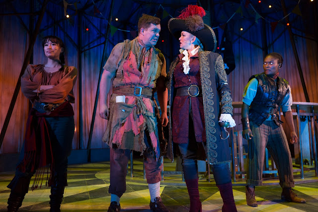 jennifer ellison as captain hook, in tricorner hat and burgundy tunic