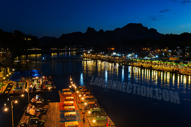 Outdoor seating at river restaurants in Vangvieng along the river
