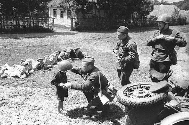 Soviet soldiers in Ukraine with children, 7 July 1941 worldwartwo.filminspector.com
