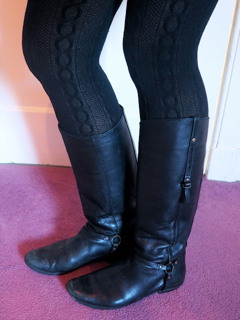 Bundled Up - outfit shoe details of tall black leather riding style boots, with black patterned woollen tights