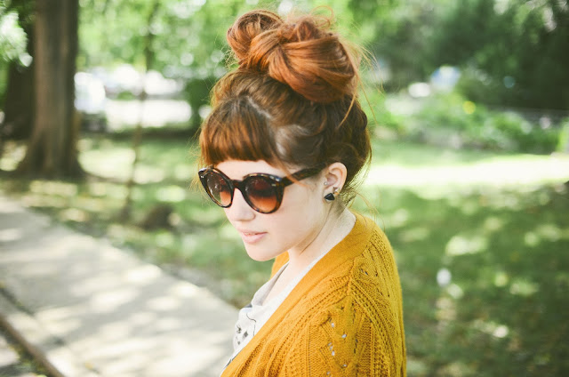 redhead, hair bow, mustard cardigan, cat eye, sunglasses