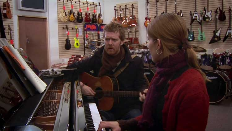 Glen Hansard and Marketa Irglova play Falling Slowly in Once.