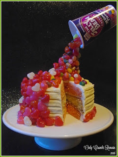 3 layered raspberry & white chocolate cake presented as an illusion cake with jelly beans