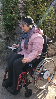 ME Advocate Ireland member Corina Duyn seated in her wheelchair