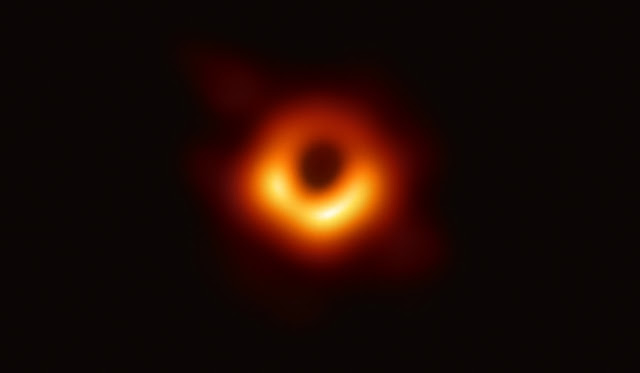 Astronomers capture first image of a black hole