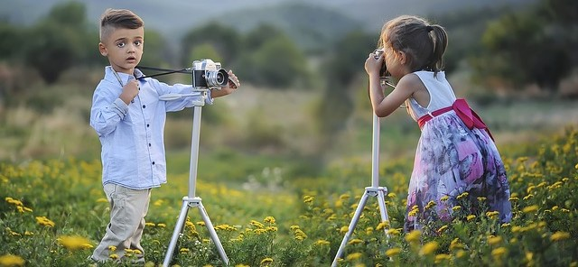 Two Kids Taking Photos of Each Other