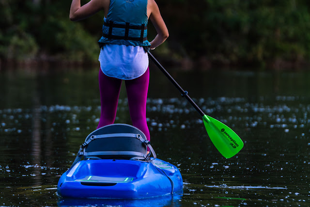 woman standup paddling on a kayak