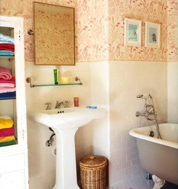Eclectic charming bathroom with rose and white wallpaper of Amanda Peet in Vogue