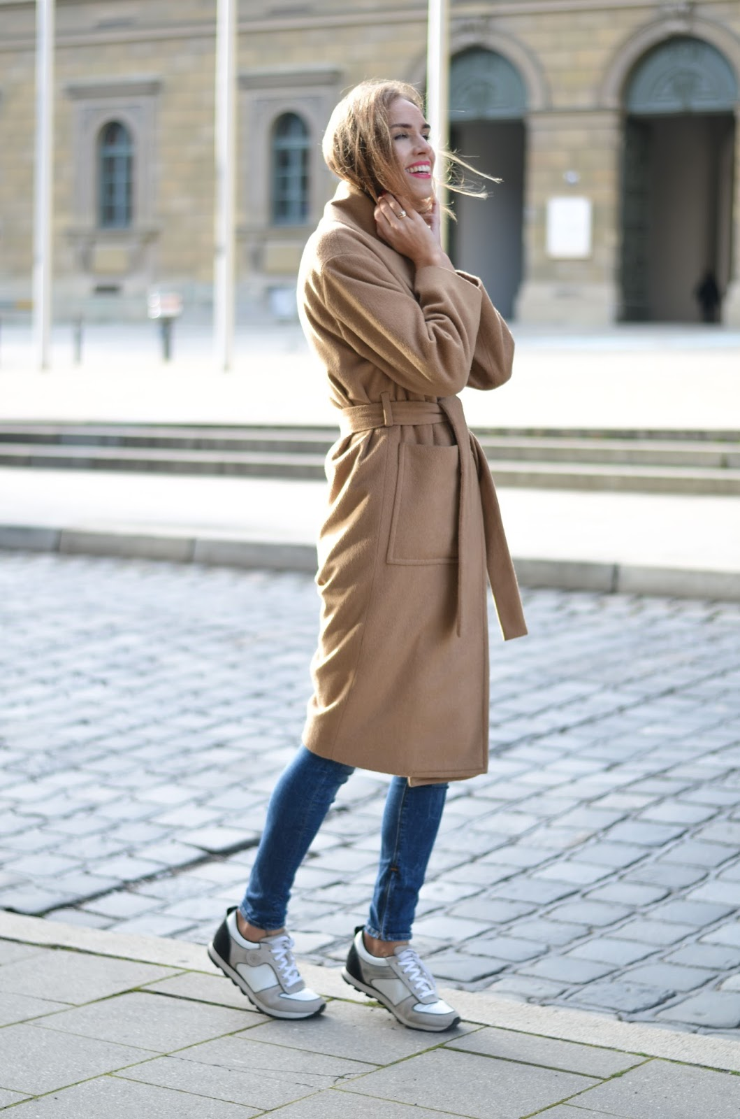 kristjaana mere mango belted camel coat skinny jeans armani sneakers winter outfit