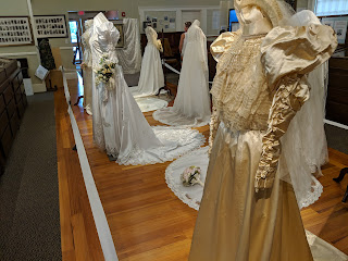 several of the bridal gowns on display