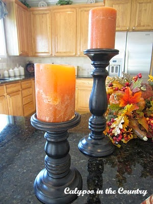 Black Candlesticks with orange candles for Halloween