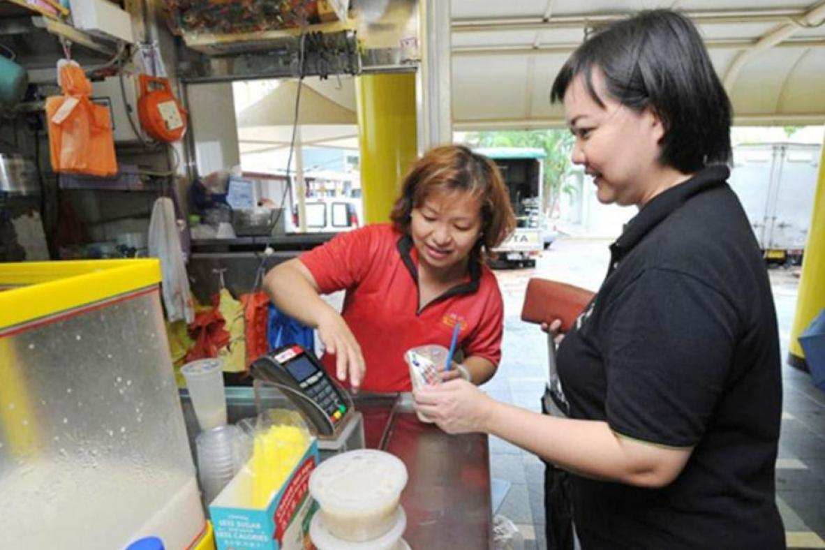 Nets, EZ-Link team up to offer cashless payment options in more than 30 hawker centres from April