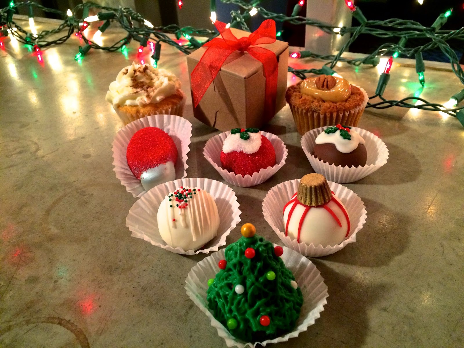 Pictured are Cupcake Allie's Pecan Pie Cupcake, Eggnog Cupcake, and Red Velvet, Vanilla, & Chocolate Cake Bites