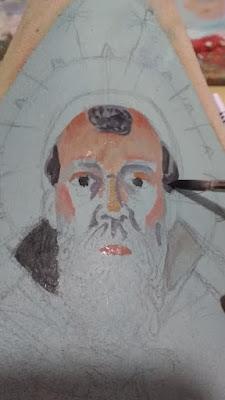 Pintando la imagen de San Saturio sobre la Bota de Vino