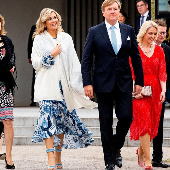 Queen Maxima wore a new royal navy crepe dress by Johanna Ortiz