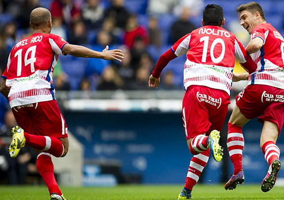 Nolito celebrates with Granada teammates after scoring the winner against Espanyol