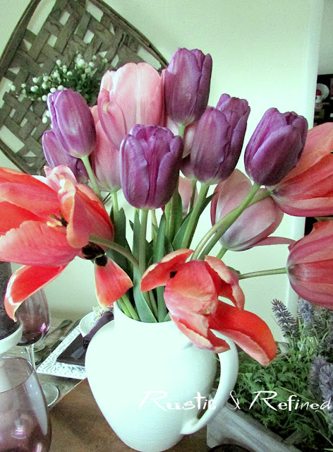 Purple and pink tulips from the garden as a table centerpiece