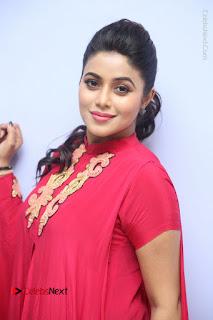Actress Poorna Latest Stills in Red Dress at Rakshasi First Look Launch  0136.JPG